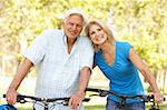 Senior Couple On Cycle Ride In Park Stock Photo - Royalty-Free, Artist: MonkeyBusinessImages          , Code: 400-05736146