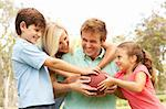 Family Playing American Football Together In Park Stock Photo - Royalty-Free, Artist: MonkeyBusinessImages          , Code: 400-05736202