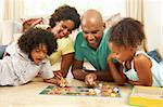 Family Playing Board Game At Home Stock Photo - Royalty-Free, Artist: MonkeyBusinessImages          , Code: 400-05736363