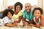 Family Playing Board Game At Home Stock Photo - Royalty-Free, Artist: MonkeyBusinessImages          , Code: 400-05736364
