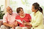 Senior Couple Talking To Financial Advisor At Home Stock Photo - Royalty-Free, Artist: MonkeyBusinessImages          , Code: 400-05736498