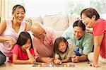 Extended Family Group Playing Board Game At Home Stock Photo - Royalty-Free, Artist: MonkeyBusinessImages          , Code: 400-05736507