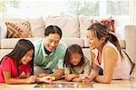 Family Playing Board Game At Home Stock Photo - Royalty-Free, Artist: MonkeyBusinessImages          , Code: 400-05736509
