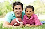 Father And Son In Park With American Football Stock Photo - Royalty-Free, Artist: MonkeyBusinessImages          , Code: 400-05736793