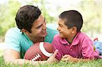 Father And Son In Park With American Football Stock Photo - Royalty-Free, Artist: MonkeyBusinessImages          , Code: 400-05736794