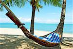 Empty hammock between palms trees at sandy beach Stock Photo - Royalty-Free, Artist: Vixit                         , Code: 400-05738557
