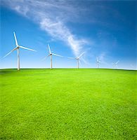 Wind turbines in an green field with cloud background Stock Photo - Royalty-Freenull, Code: 400-05739037