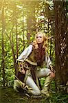 Elf holding a bow with an arrow Stock Photo - Royalty-Free, Artist: Fotolit                       , Code: 400-05739118