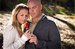 Attractive Young Couple Wearing Sweaters with a Rose in the Park. Stock Photo - Royalty-Free, Artist: Feverpitched                  , Code: 400-05741741
