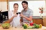 Couple drinking a glass of red wine in their kitchen Stock Photo - Royalty-Free, Artist: 4774344sean                   , Code: 400-05741858