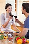 Portrait of a couple having a glass of wine while cooking in their kitchen Stock Photo - Royalty-Free, Artist: 4774344sean                   , Code: 400-05742638
