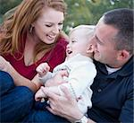 Attractive Young Parents Laughing with their Child Boy in the Park. Stock Photo - Royalty-Free, Artist: Feverpitched                  , Code: 400-05743774
