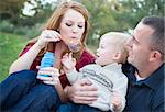 Attractive Young Parents Having Fun Blowing Bubbles with their Child Boy in the Park. Stock Photo - Royalty-Free, Artist: Feverpitched                  , Code: 400-05743775