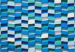 The exterior wall of an residential apartment tower is covered in an abstract pattern of rectangular shapes. Stock Photo - Royalty-Free, Artist: searagen                      , Code: 400-05743855