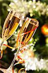 Two champagne flutes on Christmas background Stock Photo - Royalty-Free, Artist: pressmaster                   , Code: 400-05745753