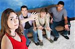 Beautiful young Caucasian lady with three disappointed men Stock Photo - Royalty-Free, Artist: creatista                     , Code: 400-05747758