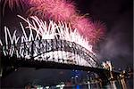 Sparkling New Year Eve nye Fireworks in Sydney Harbour Sky Line At Night, NSW, Australia, Oceania. The Sydney harbour bridge and sydney opera house sparkling in the night. Colourful surface. Night scene Stock Photo - Royalty-Free, Artist: mroz                          , Code: 400-05748719