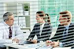 Portrait of busy people discussing new working plan at meeting in office Stock Photo - Royalty-Free, Artist: pressmaster                   , Code: 400-05749243