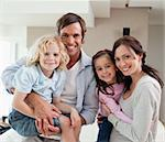 Charming family posing together in a living room Stock Photo - Royalty-Free, Artist: 4774344sean                   , Code: 400-05749708