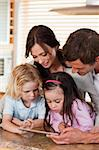 Portrait of a happy family using a tablet computer together in a kitchen Stock Photo - Royalty-Free, Artist: 4774344sean                   , Code: 400-05749718