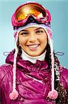 Pretty woman in goggles and winter clothes looking at camera with smile Stock Photo - Royalty-Free, Artist: pressmaster                   , Code: 400-05749971