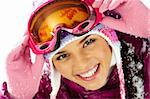 Pretty woman in goggles and winter clothes looking at camera with smile Stock Photo - Royalty-Free, Artist: pressmaster                   , Code: 400-05749976