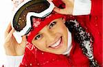 Pretty woman in goggles and winter clothes looking at camera with smile Stock Photo - Royalty-Free, Artist: pressmaster                   , Code: 400-05749977