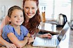 Mother and daughter together with notebook in the kitchen Stock Photo - Royalty-Free, Artist: 4774344sean                   , Code: 400-05751176