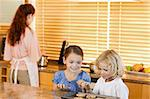 Young siblings stealing cookies together Stock Photo - Royalty-Free, Artist: 4774344sean                   , Code: 400-05751249