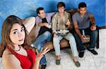 Annoyed young Caucasian woman with three men playing video games Stock Photo - Royalty-Free, Artist: creatista                     , Code: 400-05751337