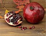 Ripe Pomegranate With Red Seeds On Wooden  Background ,Close Up Stock Photo - Royalty-Free, Artist: svetlanna                     , Code: 400-05751388