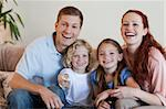 Young family watching a funny movie Stock Photo - Royalty-Free, Artist: 4774344sean                   , Code: 400-05751503