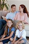 Young family spending time in front of the tv Stock Photo - Royalty-Free, Artist: 4774344sean                   , Code: 400-05751504
