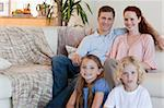 Young family sitting in the living room Stock Photo - Royalty-Free, Artist: 4774344sean                   , Code: 400-05751506
