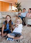 Family watching television in the living room together Stock Photo - Royalty-Free, Artist: 4774344sean                   , Code: 400-05751509