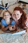 Mother and daughter on the floor reading together