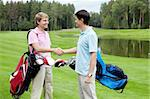 Rivals shake hands on the golf course
