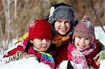 Happy friends in winterwear playing in snowdrift outside Stock Photo - Royalty-Free, Artist: pressmaster                   , Code: 400-05753655