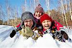 Happy children in winterwear laughing while playing in snowdrift outside Stock Photo - Royalty-Free, Artist: pressmaster                   , Code: 400-05753656