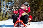 Happy friends in winterwear tobogganing in park Stock Photo - Royalty-Free, Artist: pressmaster                   , Code: 400-05753657