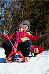 Happy friends in winterwear tobogganing in park Stock Photo - Royalty-Free, Artist: pressmaster                   , Code: 400-05753658