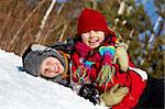 Happy friends in winterwear looking at camera while playing outside Stock Photo - Royalty-Free, Artist: pressmaster                   , Code: 400-05753665