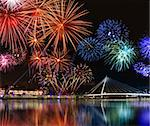 Colorful fireworks reflect from water,  beautiful bridge scenery Stock Photo - Royalty-Free, Artist: Anterovium                    , Code: 400-05754341