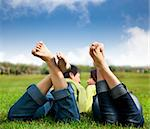 relaxed couple lying on the grass Stock Photo - Royalty-Free, Artist: tomwang                       , Code: 400-05754465