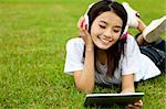 happy girl using tablet pc on the grass Stock Photo - Royalty-Free, Artist: tomwang                       , Code: 400-05754839