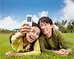 asian couple taking photo by smart mobile phone Stock Photo - Royalty-Free, Artist: tomwang                       , Code: 400-05755158