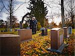Couple Grieving at Cemetery Stock Photo - Premium Rights-Managed, Artist: Matthew Plexman, Code: 700-05756326