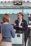 Woman at Ticket Counter in Airport Stock Photo - Premium Rights-Managed, Artist: Michael Mahovlich, Code: 700-05756435