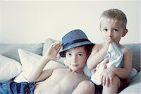 Young brothers together on sofa, portrait Stock Photo - Premium Royalty-Freenull, Code: 632-05759513