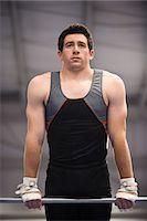 Male gymnast on horizontal bar Stock Photo - Premium Royalty-Freenull, Code: 632-05759612